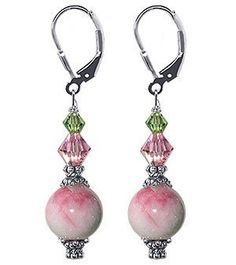 SCER018 Sterling Silver Crystal Jade Earrings Made with Swarovski Elements Gem Avenue. $16.99. Secure Sterling Silver Leverback Findings. Dimension of the Earrings is 1.5 Inch. Made in USA. Crafted with 9mm Candy Jade & Made with Swarovski Elements. Gem Avenue sku # scer018. Save 50%!