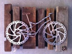 nice bike art - i think i could do this with a couple old rotors, busted chain and some copper wire... hmmm....