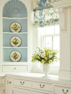 If you want color but prefer a subtle approach, flirt with color in smaller ways. Here, a shelving niche gets attention with soft French blue highlighting its architectural details. Beautiful Dining Rooms, Beautiful Kitchens, Eames, Dining Room Windows, Kitchen Decor, Kitchen Colors, Kitchen Ideas, My Dream Home, Decoration