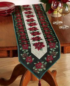 "Holiday Tapestry Table Runner By Collections Etc by Collections. $7.97. Turn every meal into a lush holiday banquet. Elegant tassels adorn both ends. Classic woven tapestry design in rich seasonal colors. Festive pattern features detailed poinsettias and pinecones. Measures 70 1/2""L x 13 1/4""W. Holiday Table Runner: Fill your dining room with holiday beauty and rich color.Tapestry table runner is woven with a pattern of poinsettias and pinecones and is so festive, it ..."