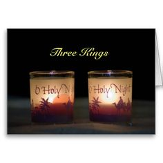"Three Kings Christmas- This card will express your feelings for the season. The words ""Three Kings"" are displayed over two lit candles whose frosted votive reads ""O Holy Night!"" Along with red silhouettes of the three wise men riding their camels to see the baby Lord Jesus. On the inside the red greeting reads ""May you experience all the Joy this season has to offer."" On the upper flap, is an excerpt from a well known Christmas poem by Henry Wadsworth Longfellow, ""The Three Kings."""