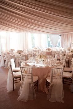 One of my favorite chair styles are the chiavari chairs.  With these chair covers you can see the chairs but the cover is also lovely. #wedding chairs
