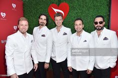 Singers Brian Littrell, Kevin Richardson, Nick Carter, Howie Dorough, and A.J. McLean of Backstreet Boys attend the 12th Annual MusiCares MAP Fund Benefit Concert Honoring Smokey Robinson at The Novo by Microsoft on May 19, 2016 in Los Angeles, California.