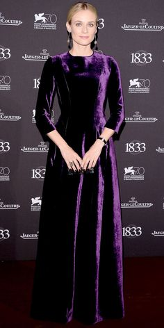At the Jaeger-LeCoultre Gala Dinner, Diane Kruger epitomized glamour in a three-quarter-sleeve dark purple velvet Alberta Ferretti Gown. She accessorized with a Jaeger-LeCoultre watch and H. Stern drop Earrings.