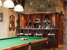 Bar and billiards grotto offer hours of extra-manly entertainment! #mancave #interiordesign #wetbar