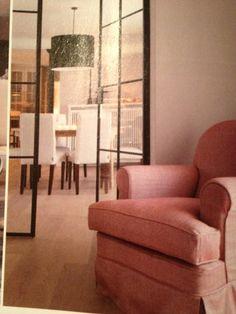 Stalen en-suite deuren tussen voor en achterkamer.
