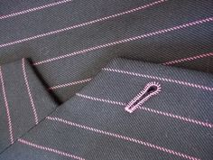Cut lapel buttonhole on the Worsted wool suit with pink satin lining, working cuff, lapelled waistcoat and matching buttonholes. Fashion Menswear, Wool Suit, Pink Satin, Buttonholes, Mens Suits, Trousers, Jackets, Dress Suits For Men, Trouser Pants