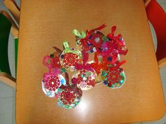 Paper ornaments with crochet and whatever children wants for decoration!