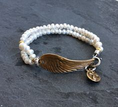 Angel wing bracelet  'On a wing and a prayer' by Mollymoojewels