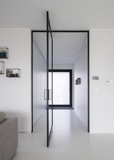 Modern glass pivoting doors made-to-measure with innovative hinges Pivot Doors, Sliding Doors, Interior Styling, Interior Decorating, Aluminium Doors, Modern Glass, Minimalist Home, Door Design, Interior Design Living Room