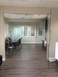 10mm clear tempered glass partition wall with swing door grandriverglass.com