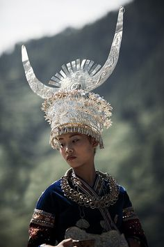 Woman from Miao ethnic group in China wearing traditional Miao head dress and clothing