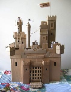 I've made several fun toys and activities for kids using cardboard, egg carton and shoe boxes but nothing like these amazing projects. You'll be blown away by these # things to make using a cardboard box, cardboard tube, egg cartons and shoe boxes. Cardboard Tube Crafts, Cardboard Castle, Cardboard Toys, Cardboard Animals, Cardboard Furniture, Diy Furniture, Cardboard Playhouse, Fireplace Furniture, Cardboard Dollhouse