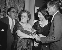 Mrs. Perle Mesta greeting Jack & Jackie, 1956