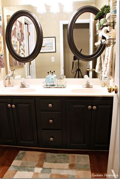 Have a plain builder's mirror in the bathroom?  Update by gluing on 2 oval mirrors to the front. Instant style!
