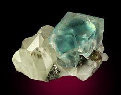 Fluorite on Quartz  Yaogangxian Mine Yizhang County Chenzhou Prefecture, Hunan Province China 9.7 x 6.3 x 5.7 cm overall 3.5 cm Fluorite