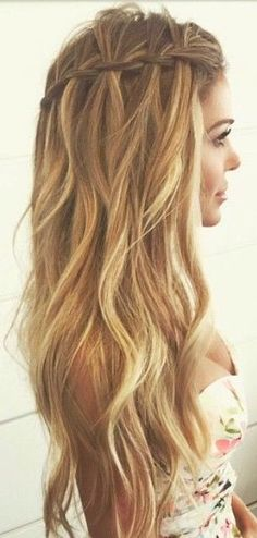 blonde hair with waterfall braid and gentle waves. It looks like a mermaid!