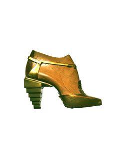 Ferragamo Gold kidskin sandal  with pyramid heel, 1930.