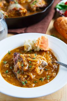 Moist and tender chicken braised in a french onion soup like sauce and topped with plenty of melted cheese!!