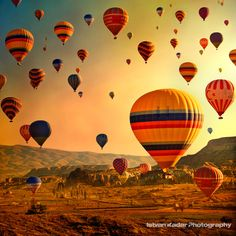Hot air ballooning in the golden light of sunrise, above the Cappadocian landscape is just like a dream.Turkey > By Alika