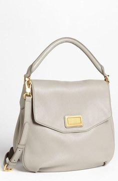 Beautiful light grey Marc by Marc Jacobs hobo leather handbag. I got this for my bday from my boyfriend. They gray is even better in person! :)