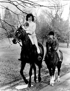 First Lady Jacqueline Kennedy and her children John F. Kennedy Jr. and Caroline Kennedy horse (and pony) riding. 11/19/62.