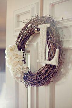 I like the idea of a simple, monogrammed wreath.