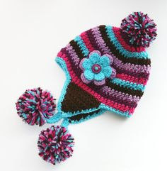 Girls hat toddler thru childs size Earflap with flower & poms crochet purple lavendar pink and teal blue. Also custom colors available. $22.00, via Etsy.