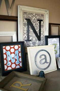 Take a picture frame, some cute scrapbook paper and a tin/metal initial and place it in the frame just like a picture...beautiful. If you initial is too thick, either remove the glass on the frame or better yet...attach the letter to the outside of the frame with hot glue
