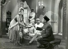 "Helen, K.N.Singh and Sohrab Modi on the sets of the movie 'Samay Bada Balwan'.  Samay Bada Balwan is a 1969 Hindi film produced and directed by Sohrab Modi. It starred Sohrab Modi, Mehtab, Aruna IRani, Sailesh Kumar, Shahida, K.N.Singh, Helen, David, Monto etc.Modi had sold his studio a year earlier but tried to revive the Minerva Movietone banner by producing this film.  The music director was Usha Khanna with lyrics written by D. N. Madhok. The notable songs were ""Teri Tasveer Se Aankhen…"