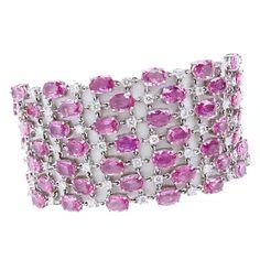 78.0 Carat Oval Cut Pink Sapphire, 6.06 Carat Round Brilliant Cut Diamond and 18 Karat White Gold Bracelet.