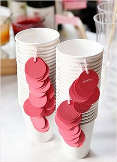 Label your paper party cups with tags (hole punch your cup and tie a small tag onto each.) Red love hearts could look cute here too.