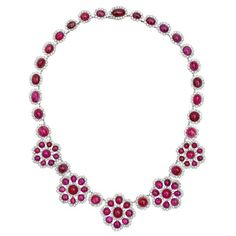 Estate Betteridge Collection Cabochon Ruby & Diamond Cluster Necklace    Ruby and diamond cluster necklace in platinum. Cabochon-cut rubies weighing approximately 80.00 total carats and circular-cut diamonds weighing approximately 13.50 total carats.