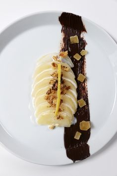 Poached pears are sexy. Poached pears plated with candied ginger, toasted walnuts and crème anglaise with a swipe of chocolate are even sexier. Inspired by the movie Burnt.///
