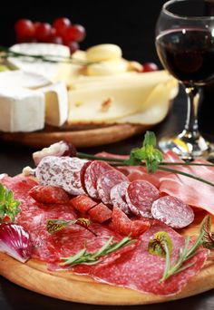Salami with cheese platter and herbs