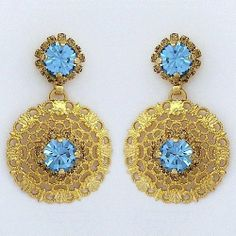 """Aqua & Gold Filigree Drop Earrings Zzan Jewelry. $110.00. Aqua crystal center bordered with golden shadow crystals. Swarovski crystal, 24kt gold plated.. Delicate gold filigree design. Filigree design is 1"""", earrings hang at 1 5/8"""".. Friction back posts"""