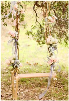 a swing set covered in roses and green vines