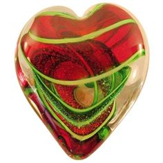"""Scarlet and Green Dichroic Heart Paperweight This beautiful heart shaped paper weight contains bands of transparent scarlet red, sparkly green dichroic, and canes of opaque lime green spiraling and folding inside the heart.  Handmade by artists at the Glass Eye Studio.  It is made with recycled glass and contains ash from the 1980 Mt. St. Helens eruption. It is approximately 2 15/16"""" wide x 3 5/8"""" long."""