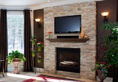 Give new life to an old fireplace by recovering it with stone veneer panels from Realstone Systems. Product: Sierra Shadowstone Stone Veneer