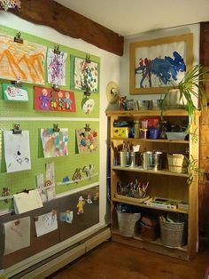 Great idea to display kids artwork, love the plant bookshelf too.