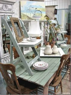 Booth Display Idea -- Chairs on Table adds height and interest that draws potential customers.