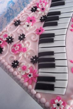 Piano and Pink - 1/4 sheet cake iced in BC with MMF decorations.