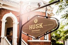 6. The Bar at Husk - South's Best Bars - Southernliving. Next door to chef Sean Brock's popular restaurant Husk is The Bar at Husk, a freestanding Victorian-era home beautifully restored to suit its surroundings in historic downtown Charleston. Famous for its boozy Light Dragoon's Punch, but also host to a menagerie of thoughtful, potable cocktails, Husk boasts one of the largest bourbon selections in the area—and yes, you can get Pappy here.  76 Queen St., Charleston, SC 29041