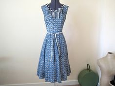 "1950s Dress / Stunning detailed full-skirted dress in blue with matching belt / L-XL / 32"" waist. £65.00, via Etsy."