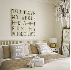 BEDROOM Wall hanging & pillows. Love the neutrals.