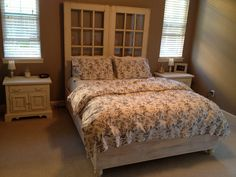 Bed made by hand with French doors as headboard. Mostly reclaimed lumber. Made by my hubby.