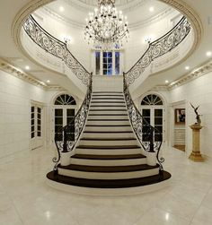 A staircase in your home can be a perfect interior symbol to bring a luxury design style. A big home with a big stair too usually is more recommended to have a luxury style on it. The staircase is als Luxury Staircase, Grand Staircase, Staircase Design, Staircase Ideas, Modern Staircase, Double Staircase, Dark Staircase, Stair Design, Foyer Ideas