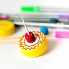 How to make a spinning top from plastic bottle caps - Follow @Guidecentral for #crafts and #DIY projects
