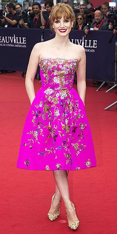 JESSICA CHASTAIN She's long challenged the color commandment that redheads can't wear pink, but the Oscar nominee takes her rule-breaking to another level with this nearly-neon dress featuring gold floral embroidery, seen at the opening ceremony of the Deauville American Film Festival in Deauville, France.