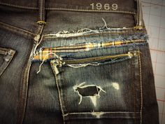 patched jeans with a peep of plaid :: reconstructed denim :: casual menswear style